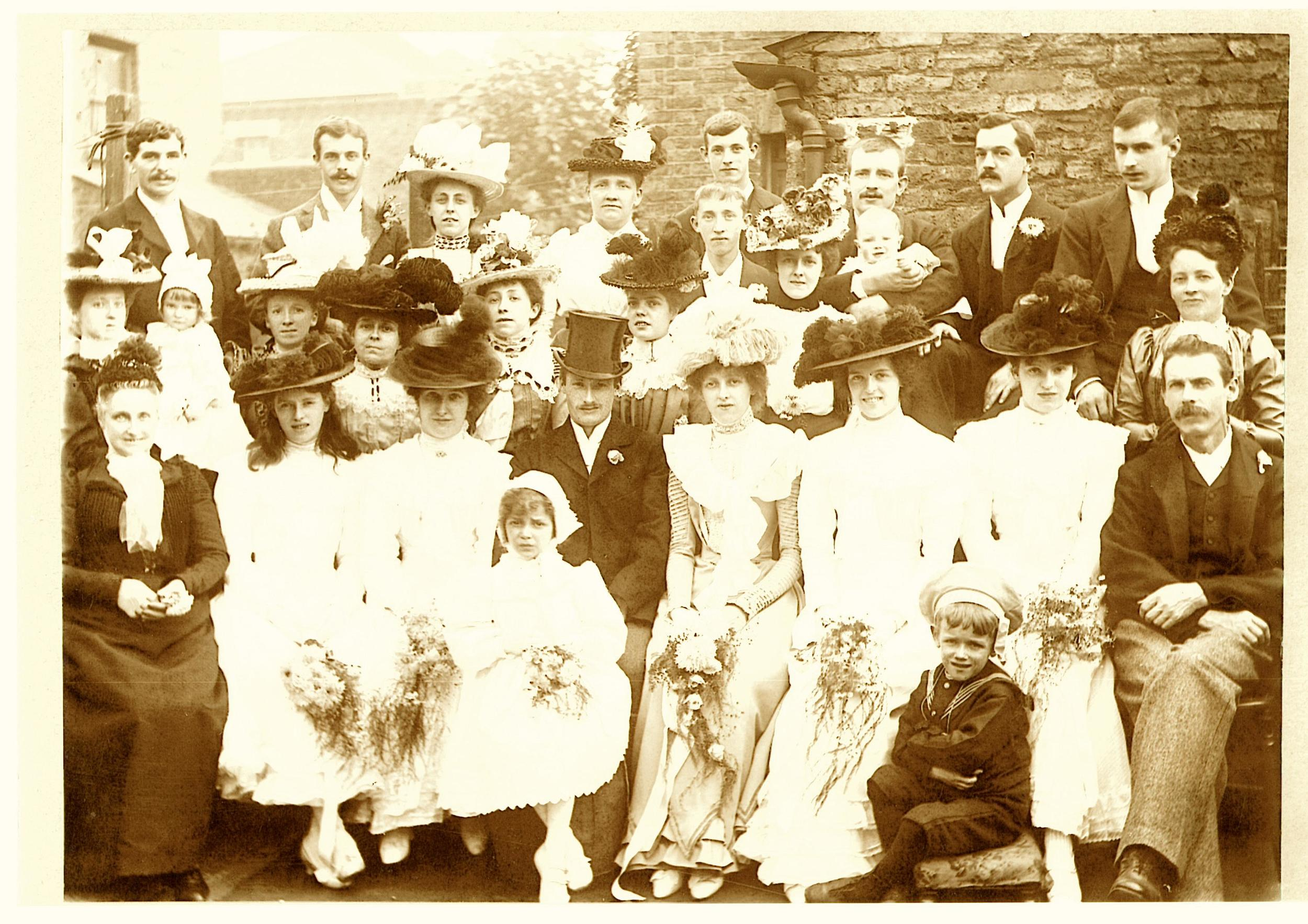 James is sitting on front row on the far right, and standing behind him is his wife Emma.The bride is my great grandma,James' daughter Emma Evans Threlkeld, and the groom is my great grandpa,John Way. I love the rakish angle of his hat!This photograph was taken on 15th September 1901. In two days' time it will be their 144th wedding anniversary.