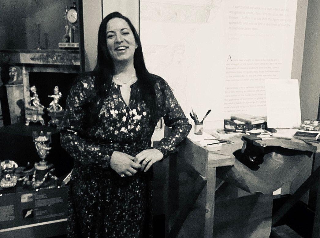 The only picture of me from the Private View, casually leaning on my workbench, currently installed in the Silver and Metals Gallery.  Photo Credit - with thanks to Paula Moore @TalkinCulture