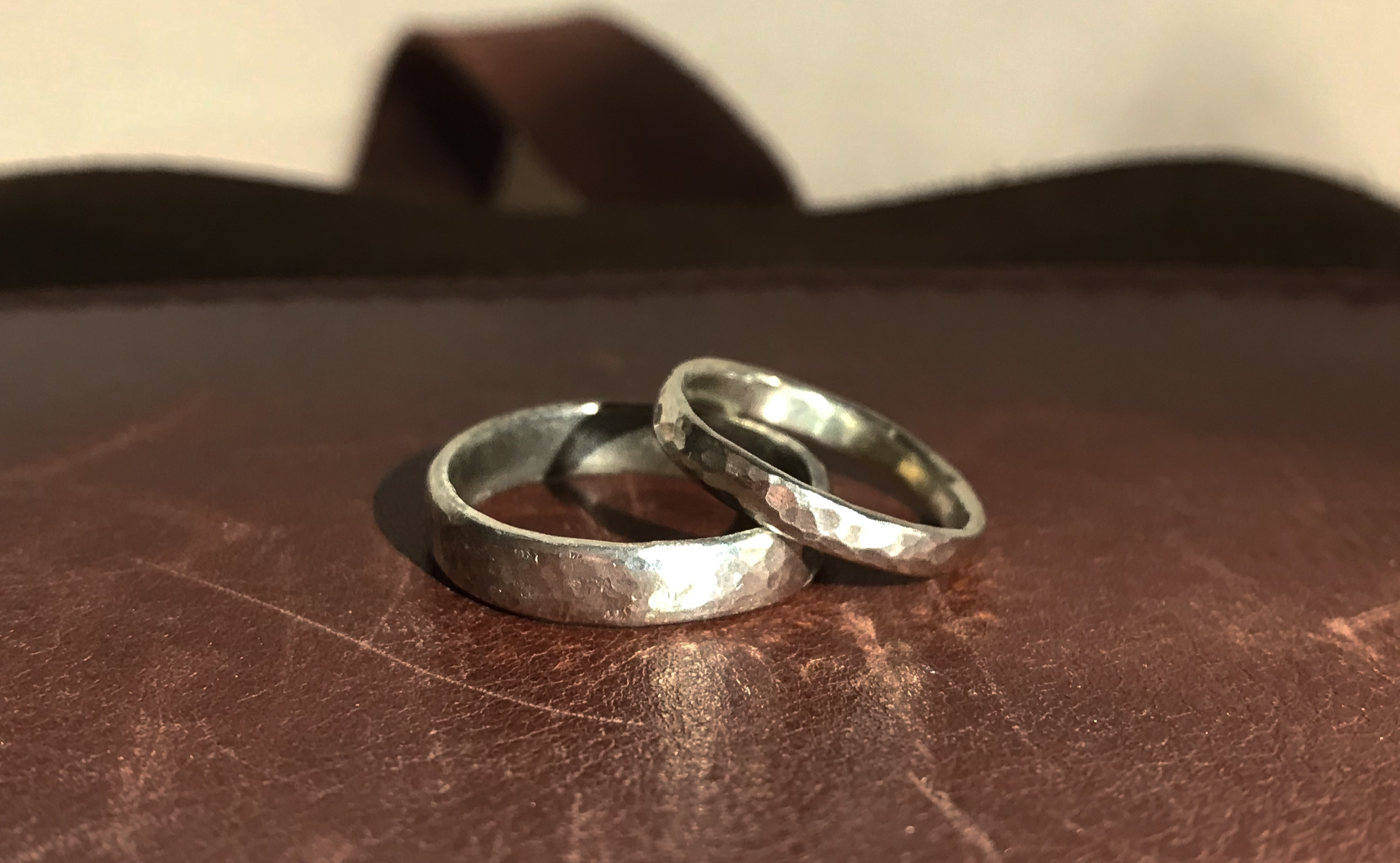 A pair of wedding rings in 9ct white gold, handmade by Charlotte and Darren from their   Make Your Own Wedding Rings   workshop with us at the end of February.