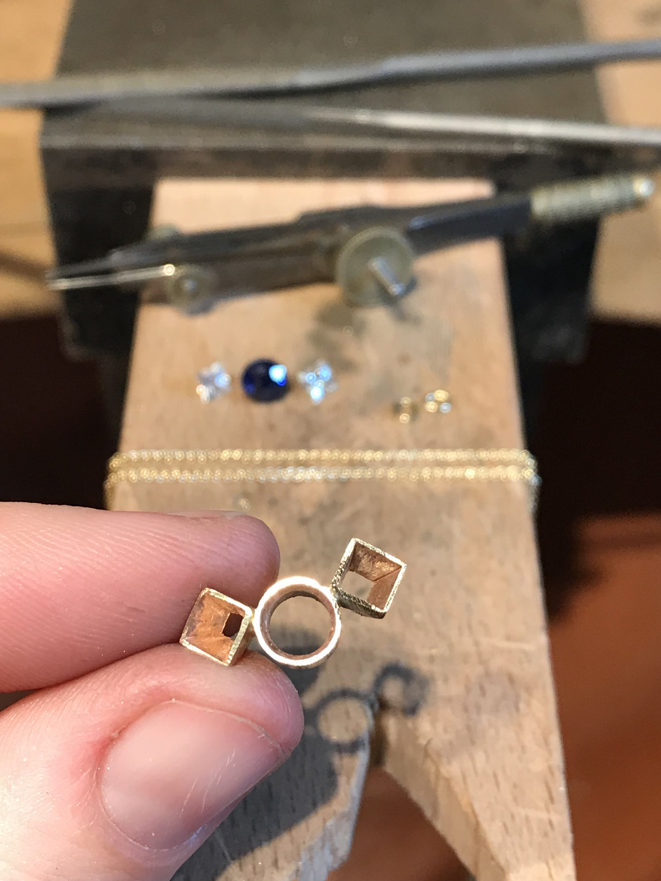 A custom 9ct yellow gold pendant in progress, with entirely handmade collets. Spring 2019.