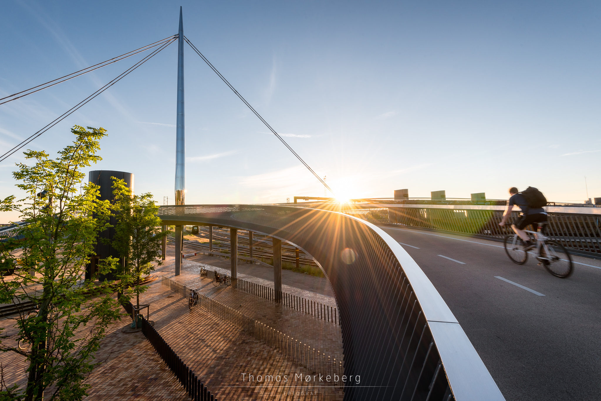 Cyclist going over the City Bridge (Byens bro) in Odense, Denmar