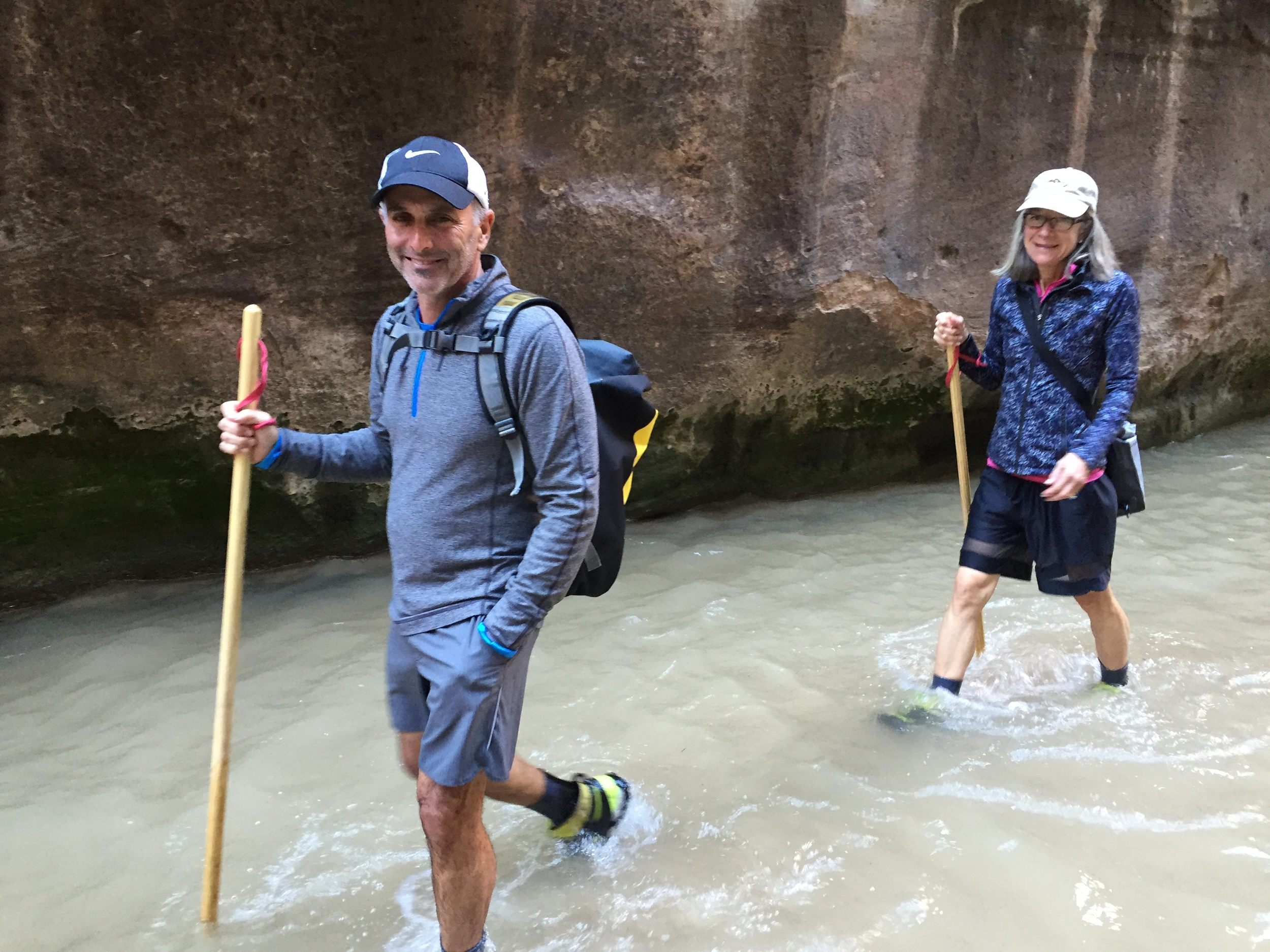 Hikers rent special shoes and sturdy hiking sticks to hike The Narrows.