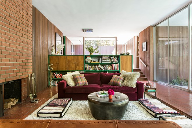 """- When Brynn Jones and her fiancé, Ness Saban, first set foot inside their Hollywood Hills house, they felt like they were stepping into another era. The three-bedroom, Robert Lee–designed split-level still boasted many of its original mid-century features—right down to the shag carpet in the sunken living room. """"We both really fell in love with all of it: the wood-paneled walls, the big brick fireplace, and the amount of natural light that comes through the house,"""" recounts Jones.Read more . . ."""