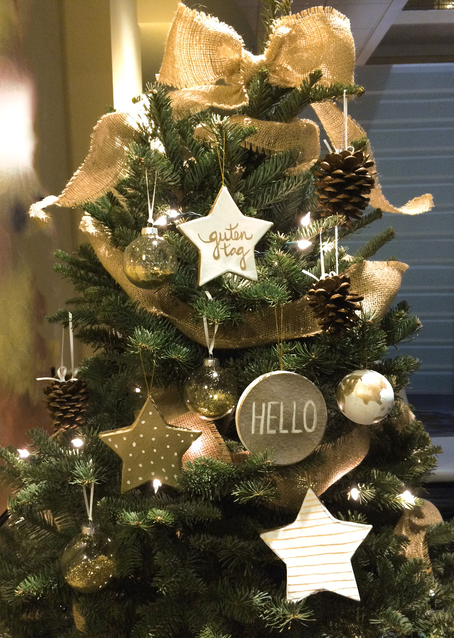 """Cadence employees spent a day crafting handmade globe, pinecone and """"Hello"""" ornaments for the charity."""