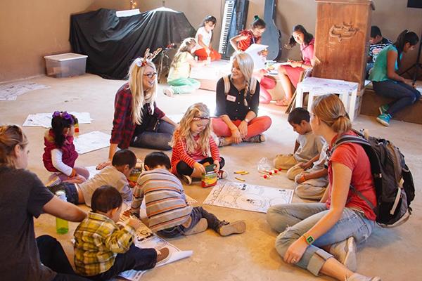 Volunteers host activities for the local children.