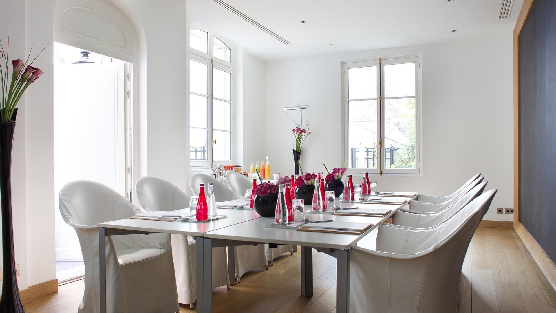 A bright, airy meeting room at Le Royal Monceau - Raffles Paris.