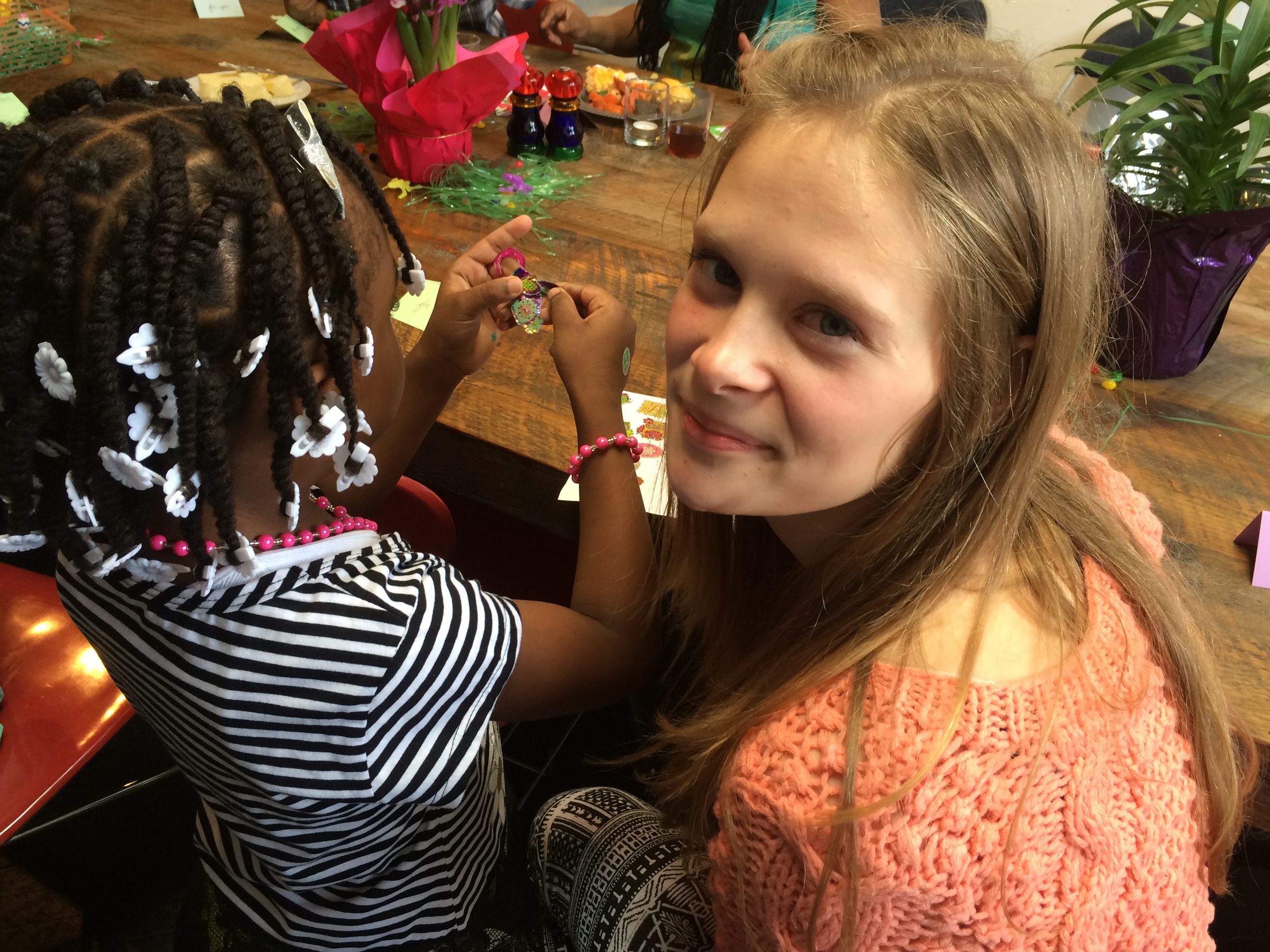 ONE OF OUR YOUNGER VOLUNTEERS, WHO ATTENDED WITH HER MOM ON EASTER HELPING THIS LITTLE ONE DESIGN AN EASTER EGG TO TAKE HOME #HOLIDAY #FAMILY #TRADITIONS