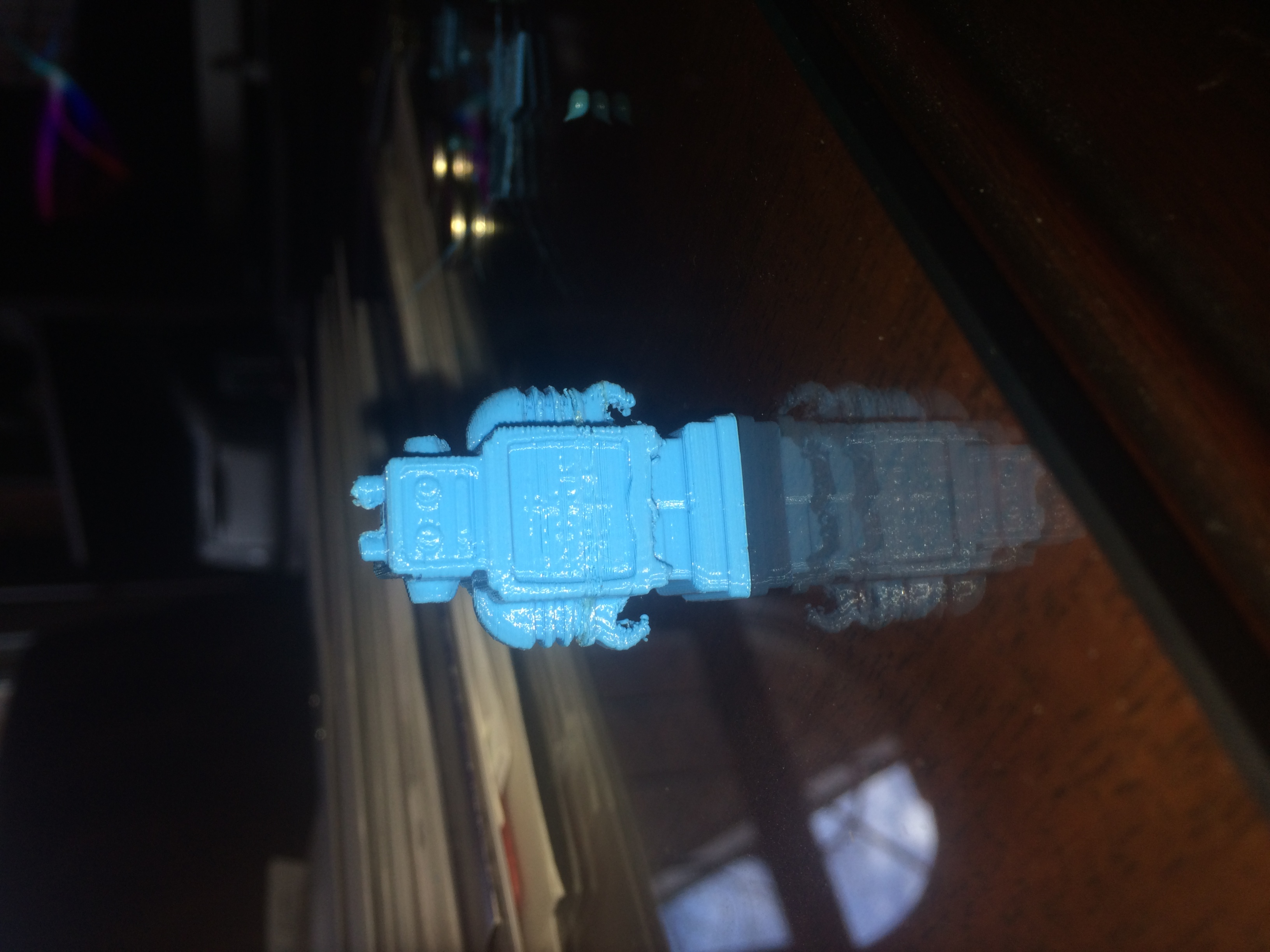The results of the first print. There were uneven layers, and the hands barely took shape.