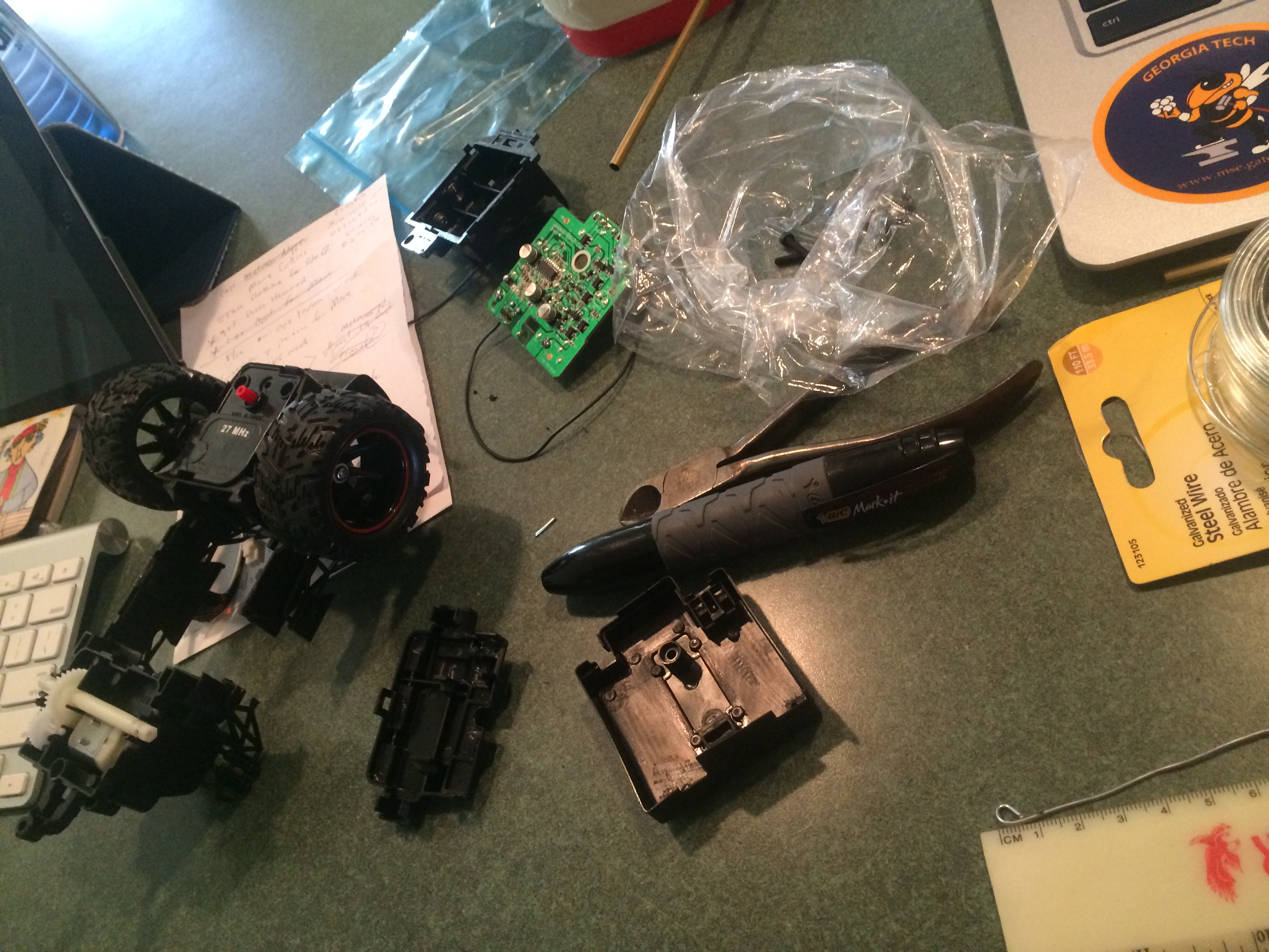 Taking apart the RC car and saving the motor, circuit board, and battery holder.