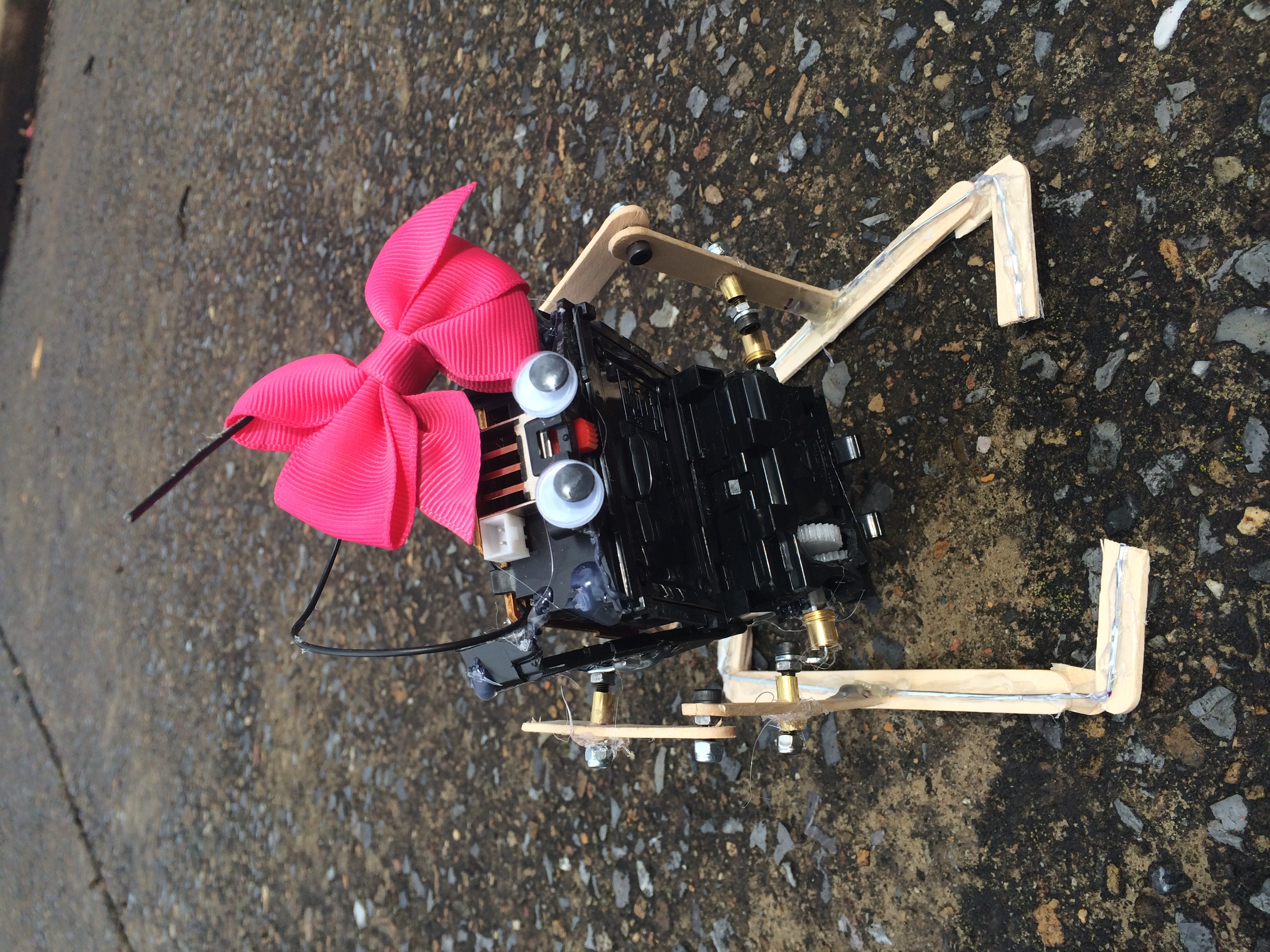 The finished robot with Popsicle stick legs. This was especially pleasing since the printed gear work rather well. Unfortunately, The galvanized wire and Popsicle sticks caused the robot to be tediously hobbling back and forth.