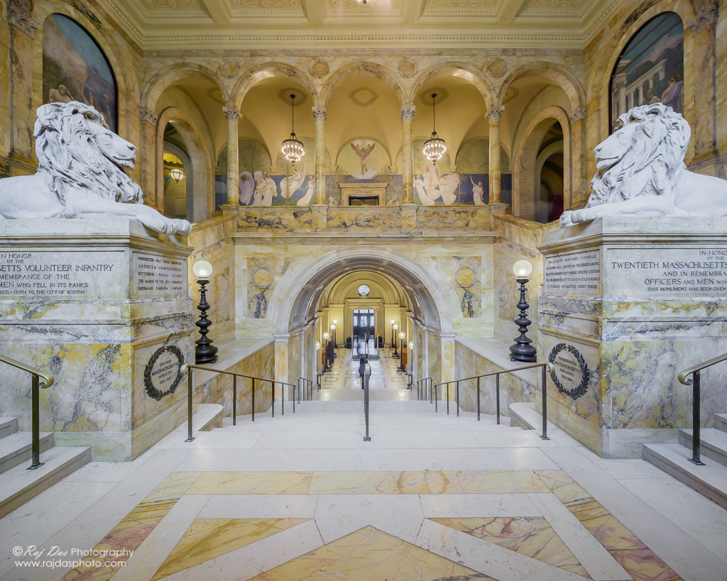 The main entrance staircase to the McKim Building with the twin statues of lions, sculpted by artist Louis Saint-Gaudens.