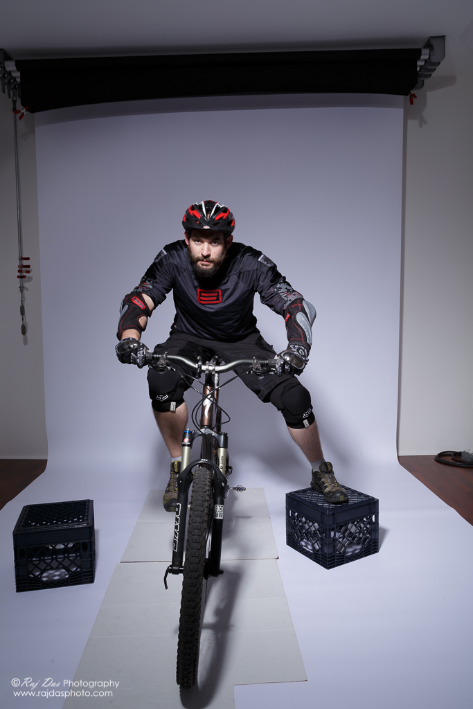 Jason on his bike in the studio with right foot on pedal
