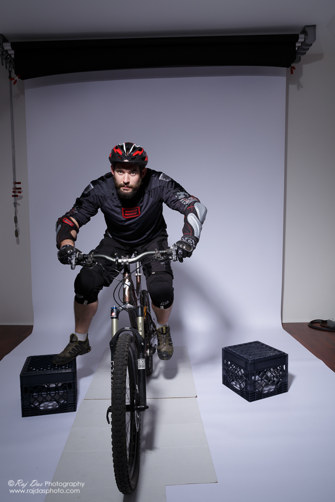 Jason on his bike in the studio with left foot on pedal