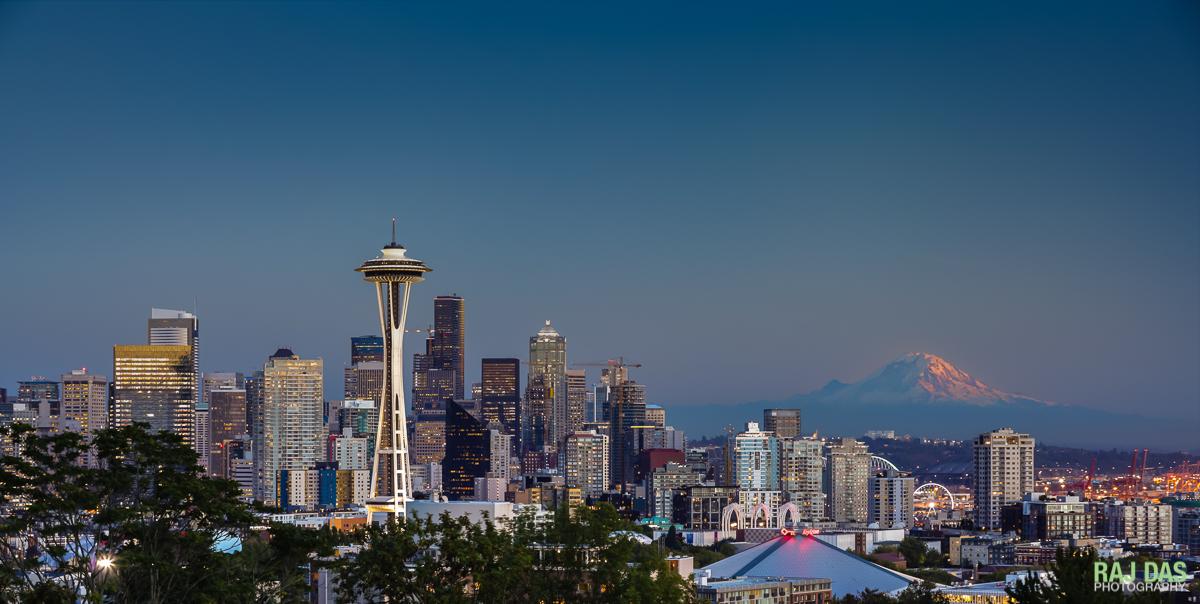 Dusk settles over Seattle as the last rays of the setting sun kiss the peak of Mt. Rainier