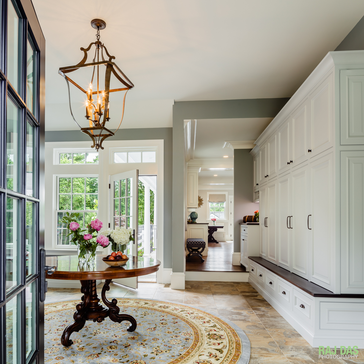 Mud room and view into outdoor patio and kitchen area