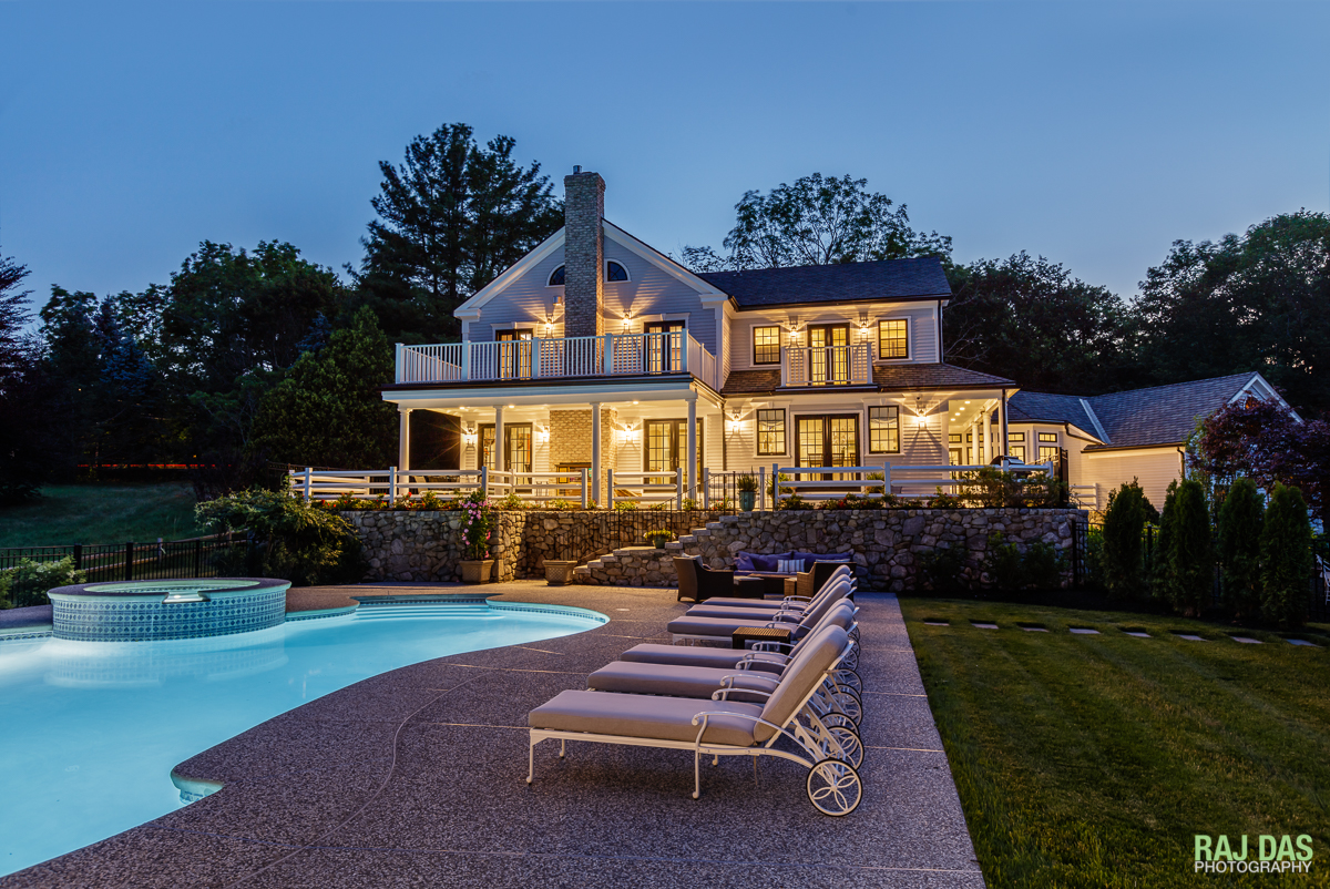 Pool side view of the residence at dusk