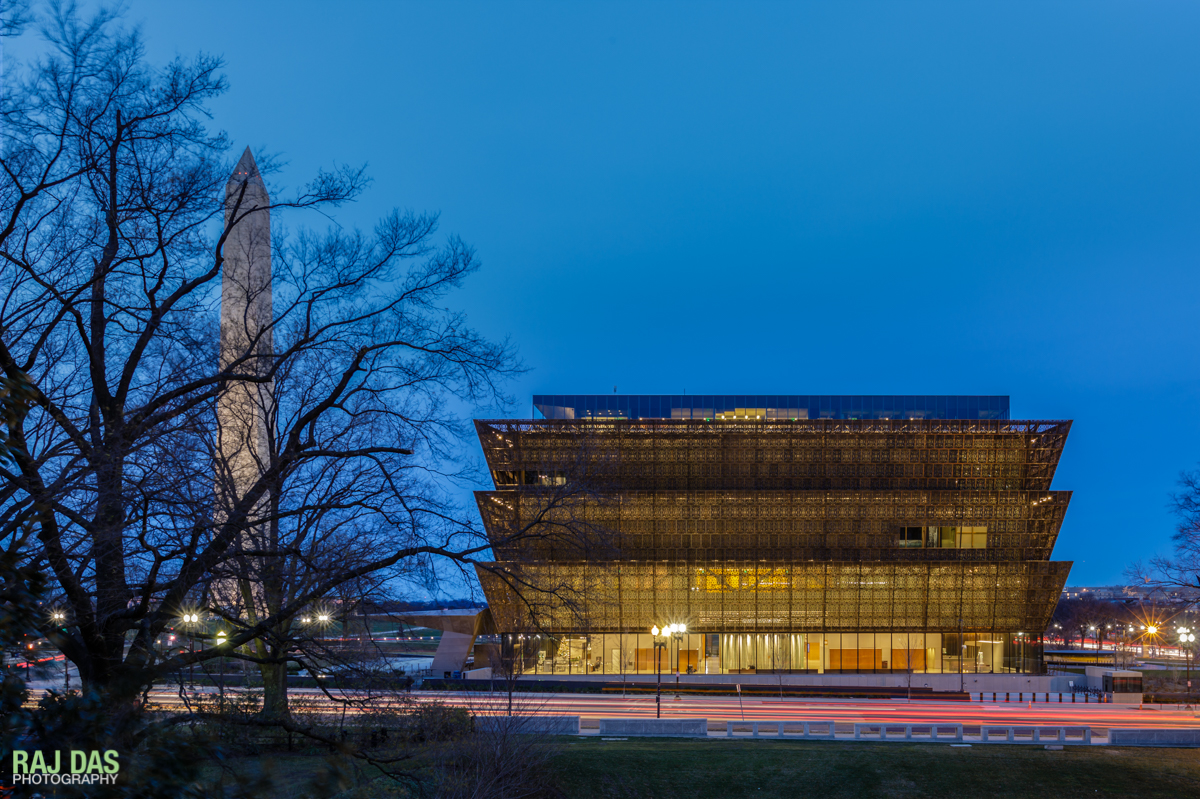 View of the Museum and the Washington Monument with the traffic on 14th Street at dawn
