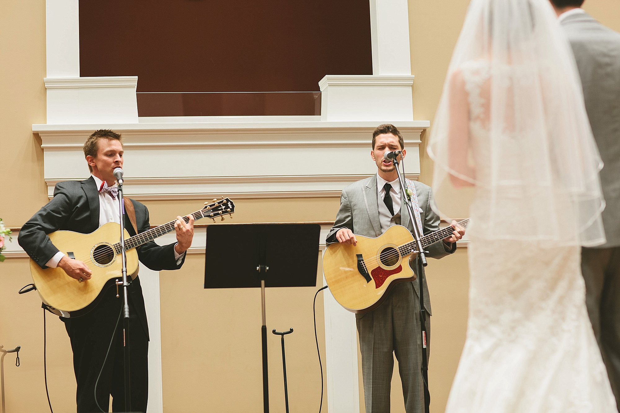 "Ronnie and my brother Zack singing ""Grace Alone"" at our wedding (Photo by Naisang Photography)"