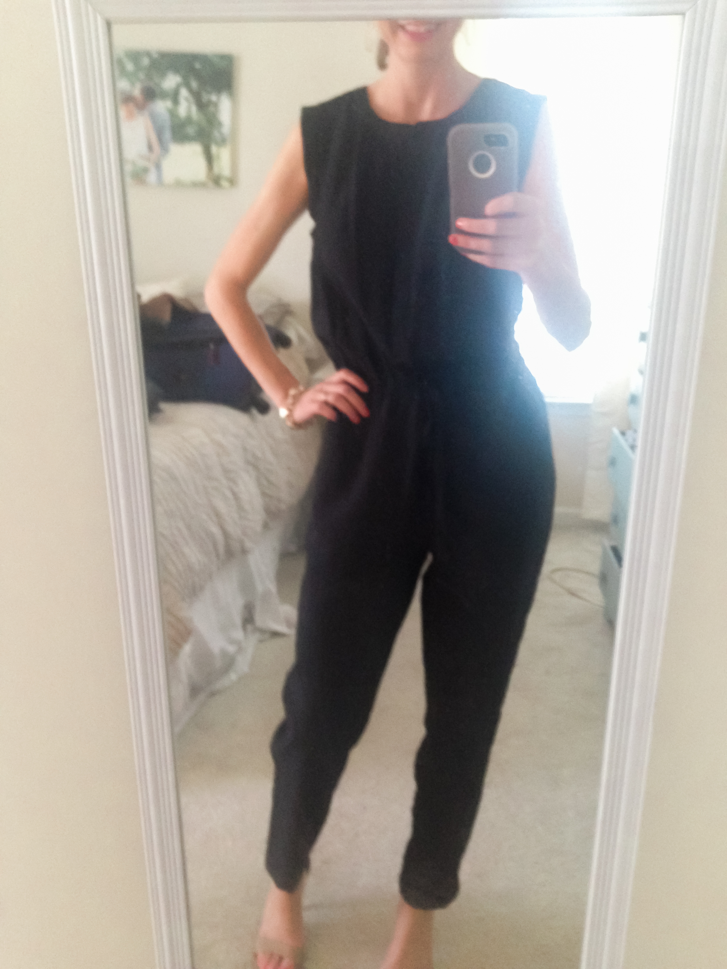 Sorry about the super low quality of this picture! I just wanted to give you an idea of what the   jumpsuit   looks like. I'll have a full outfit post on it soon but wanted to go ahead and share it since it's ON SALE FOR $32!!