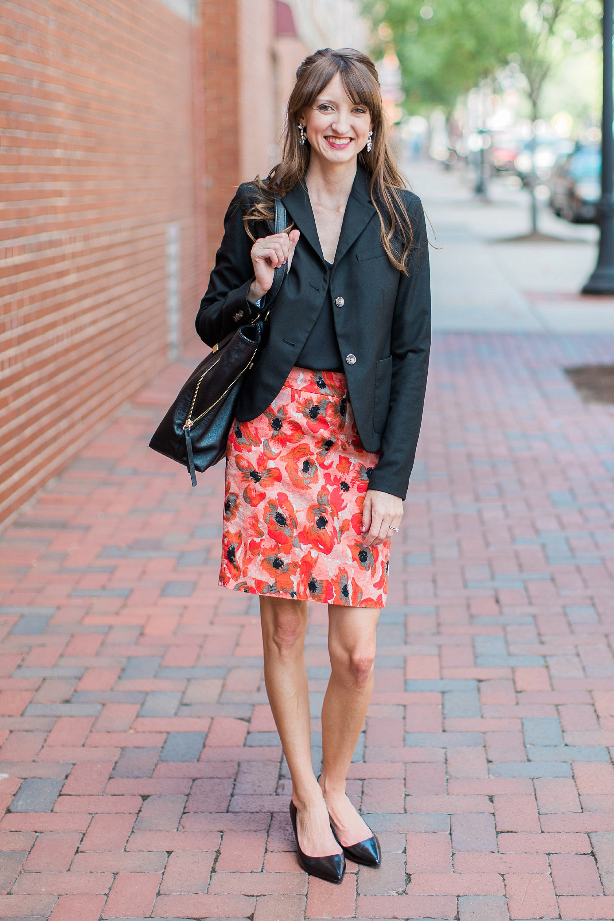 """BLAZER: Gap (Similar   here   and   here  ); TOP:   Topshop  ; SKIRT: Ann Taylor (similar   here   and   here  ); SHOES:   Nine West  ; TOTE BAG: Banana Republic (similar   here    and 40% off!); EARRINGS: J Crew (similar   here  ); LIPS:   Revlon Lipstick   in """"Wine With Everything;"""" CLUTCH PURSE (shown later): Francesca's (similar   here   and   here  ). Photos by   Sammi Evans Photography  ."""