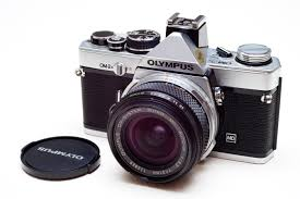 The Olympus OM2-N - This was my first encounter with an SLR (Single Lens Reflex) camera, and it would become a game-changer.