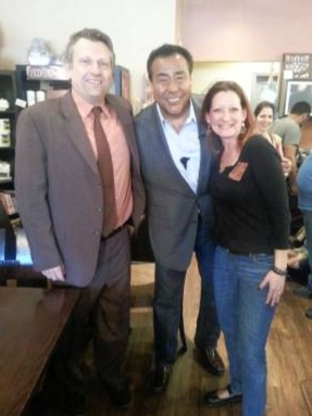 """Rhonda and Jon Mallek, owners of The Fine Grind Coffee Bar, located on 101 Newark Pompton Turnpike, saw their business recently filmed for the reality program """"What Would You Do?"""" hosted by John Quinones. Pictured are the Malleks and John Quinones."""