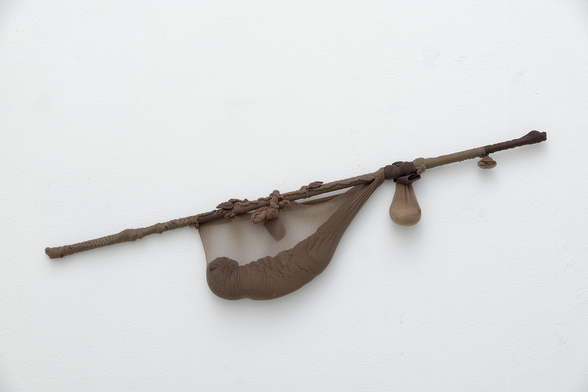 """Untitled"", 2011. Nylon Mesh, Sand, Found Object. Photo by Propecia Leigh."