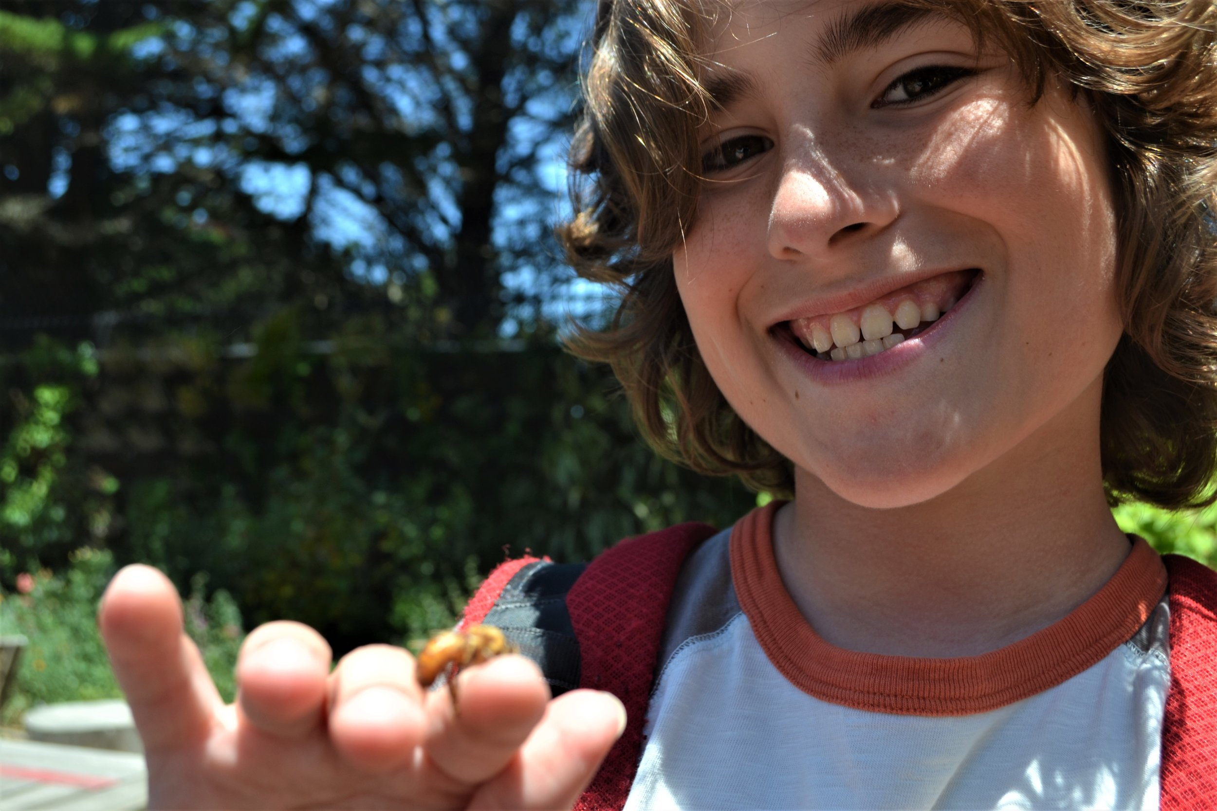 A camper holds Sebastian, our (briefly) pet drone!