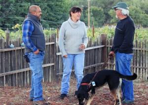 Vineyard manager Ulises Valdez (left) with Celeste and Clay Gantz