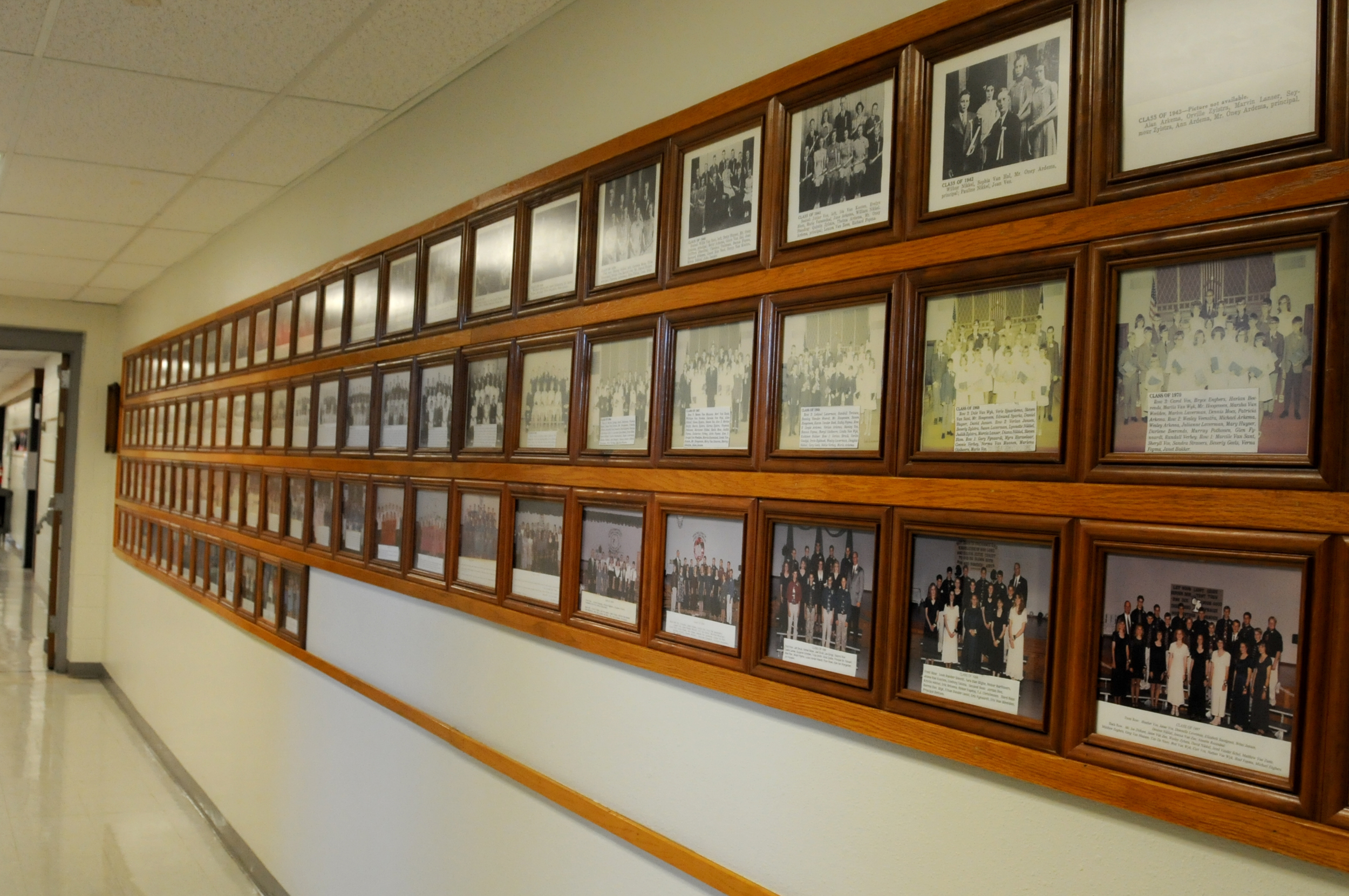 This hallway highlights the graduating class photos, starting with the class of 1919.