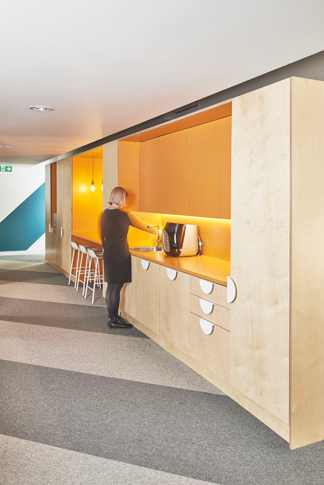 Storage wall featuring drinks point and touchdown nooks