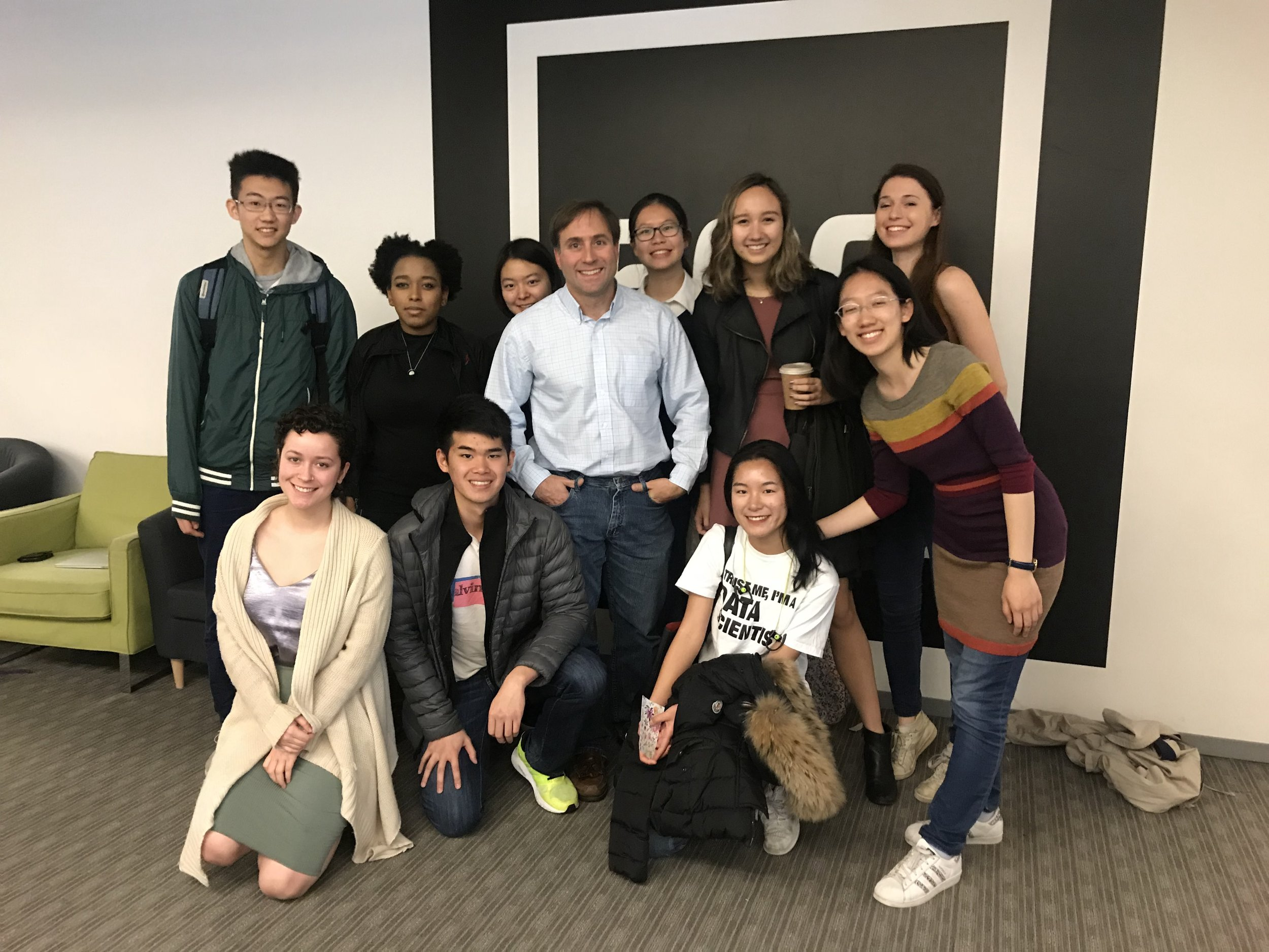 The team from Wes posing in front of the 500 Startups logo with Robert Neivert '90