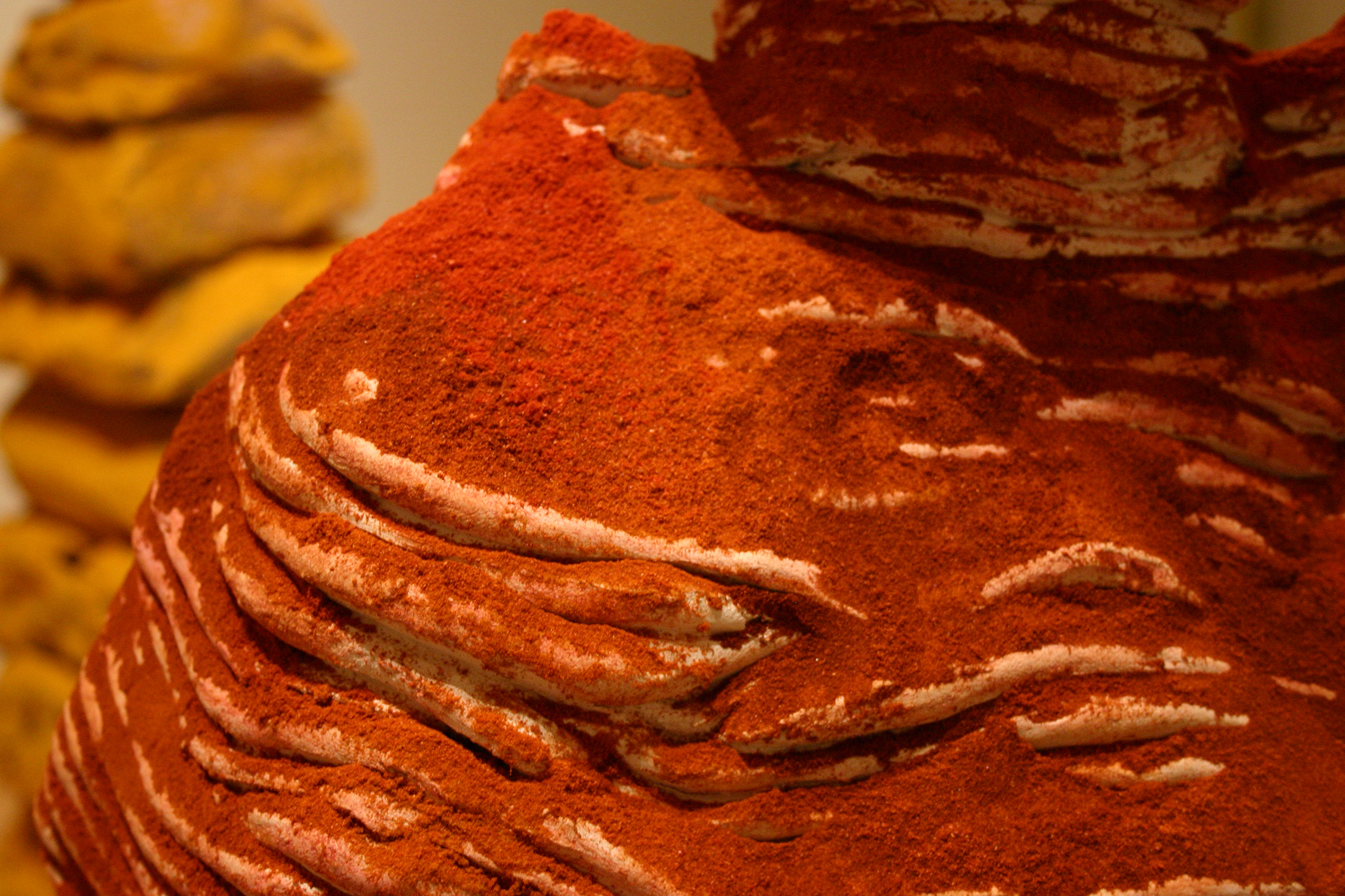 Detail of the red spice on the ceramic sculpture