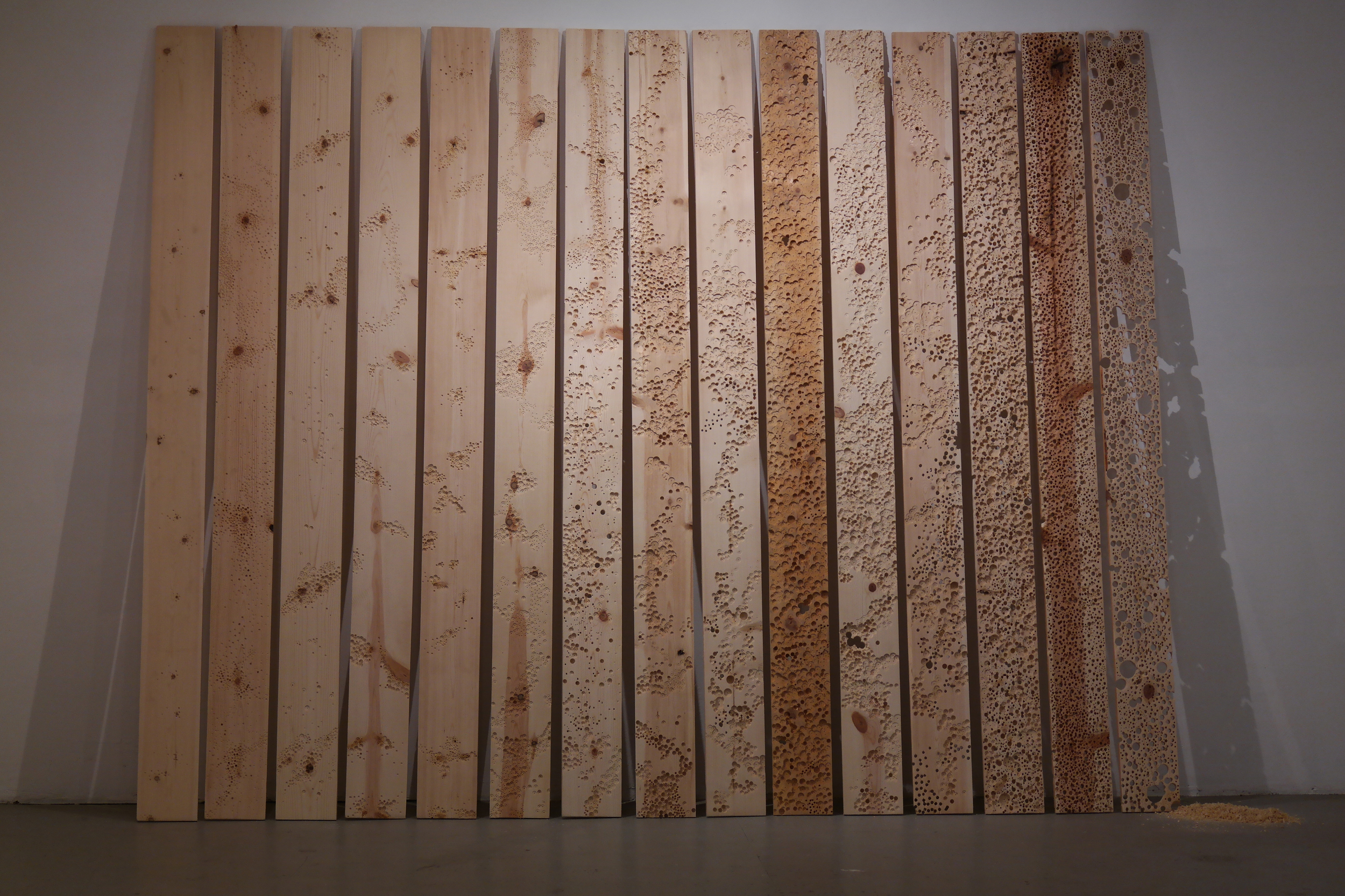 Close-up of the drilled wood panels