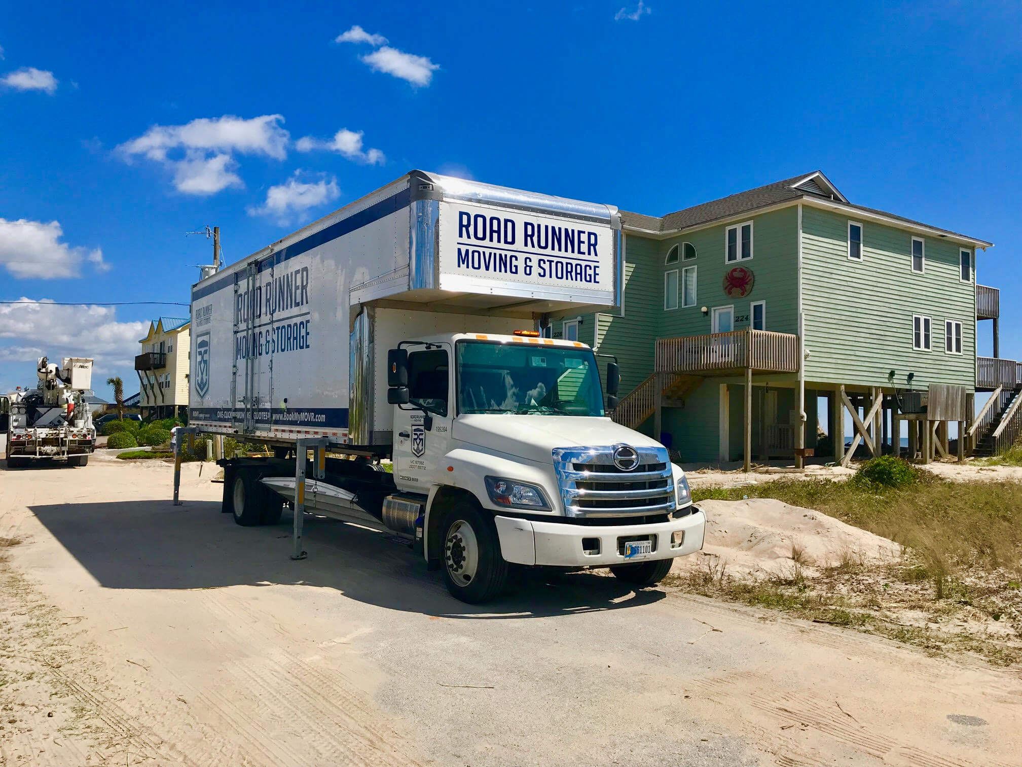 Road Runner Moving truck shown in Top Sail Beach, North Carolina after Hurricane Florence made landfall in September 2018. Our teams spent nearly 4 months in North Carolina after the storm helping hundreds of residents from Wilmington, NC to Jacksonville, NC.