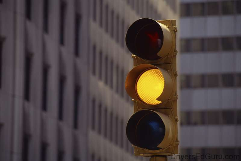IN GENERAL, UNLIKE MD AND VA., A YELLOW LIGHT MEANS STOP IN DC.