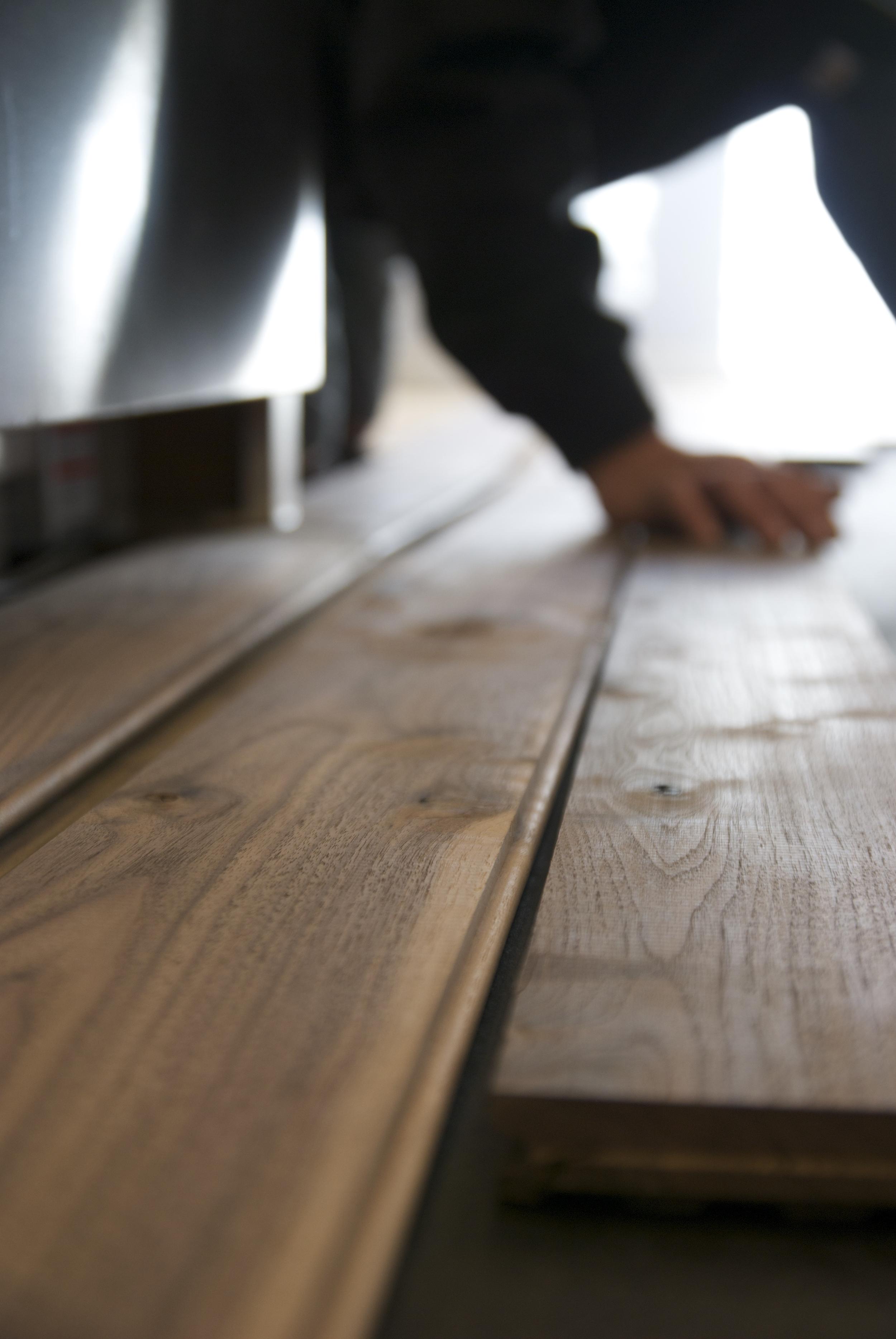 Steve Clifton of ASA Flooring laying hardwood floors in Denver