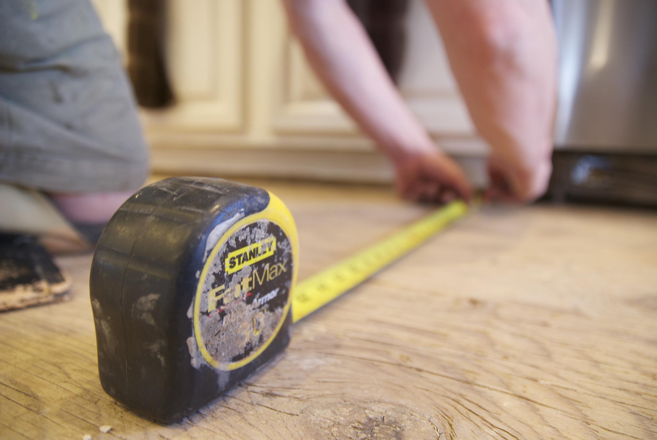 Steve Clifton of ASA Flooring measuring hardwood floors in Denver