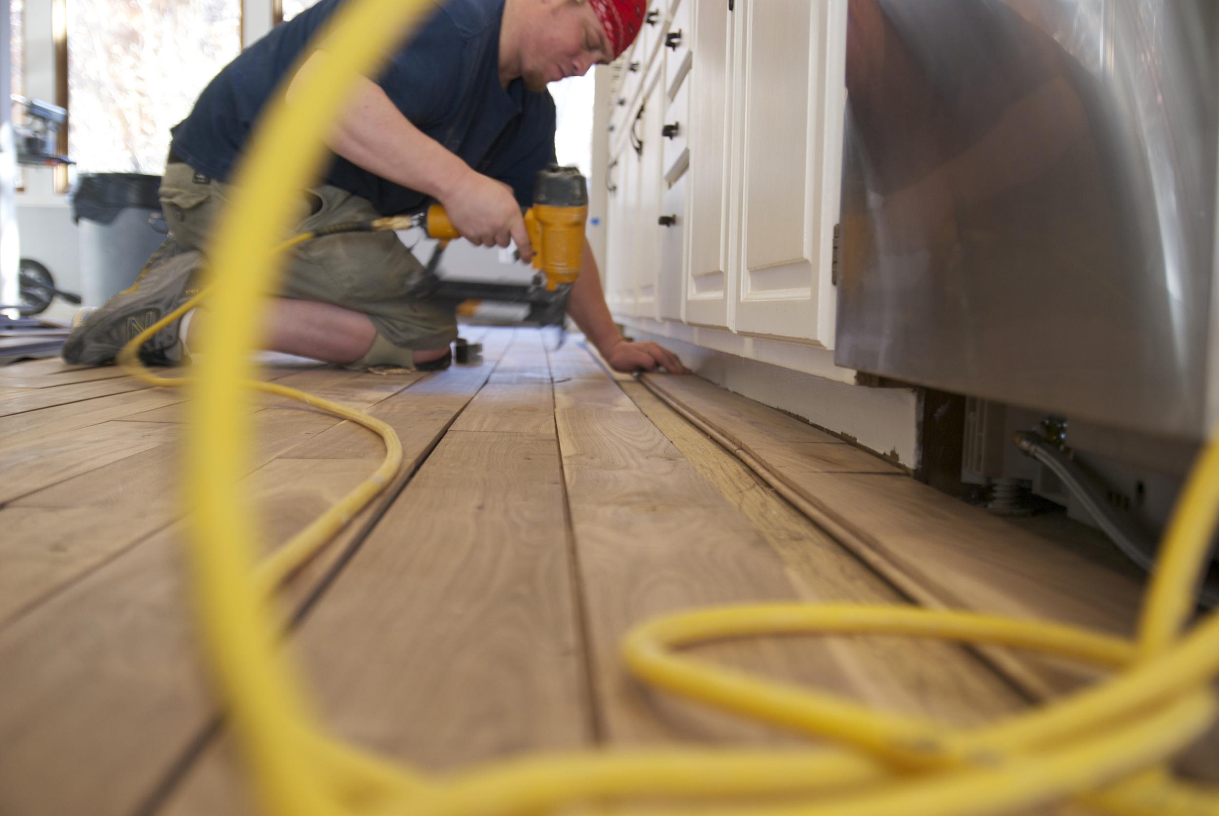 Steve Clifton of ASA Flooring nailing hardwood floors in Denver