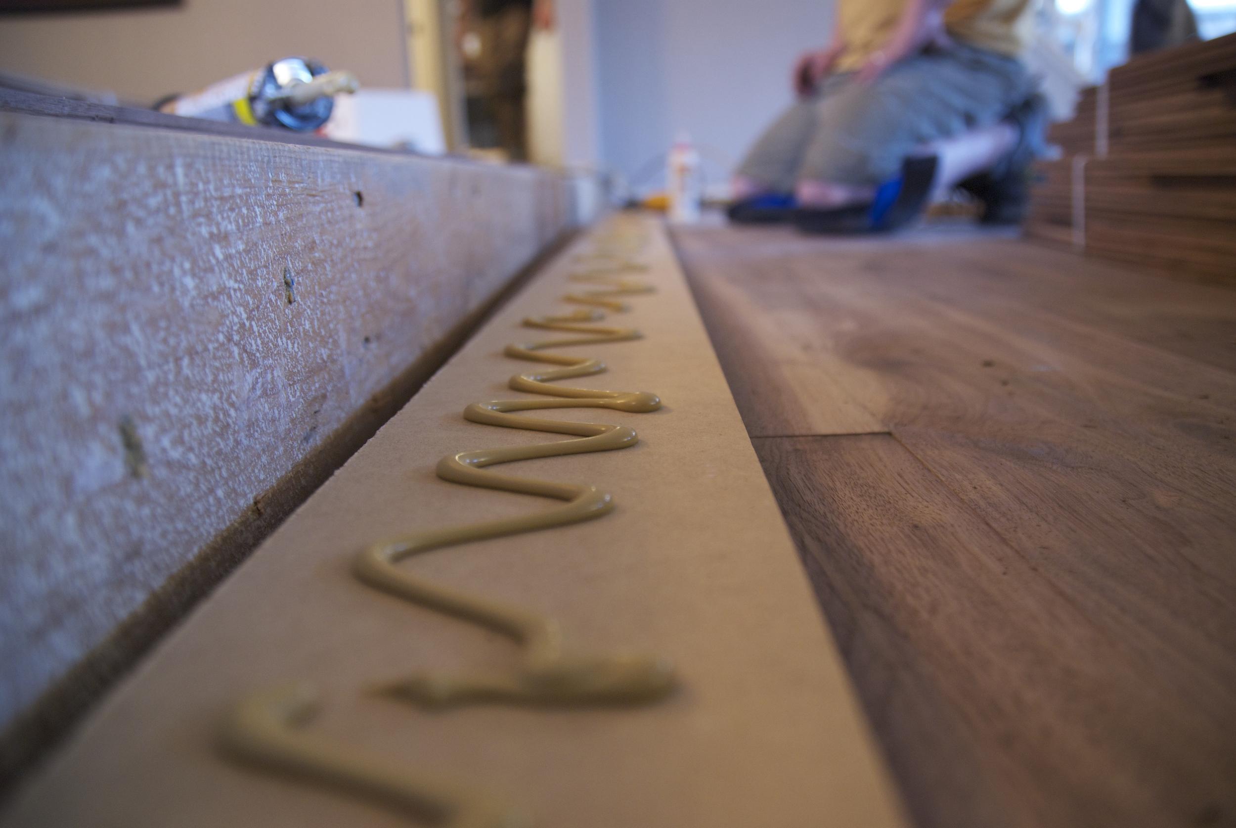ASA Flooring gluing hardwood floors in Denver, CO