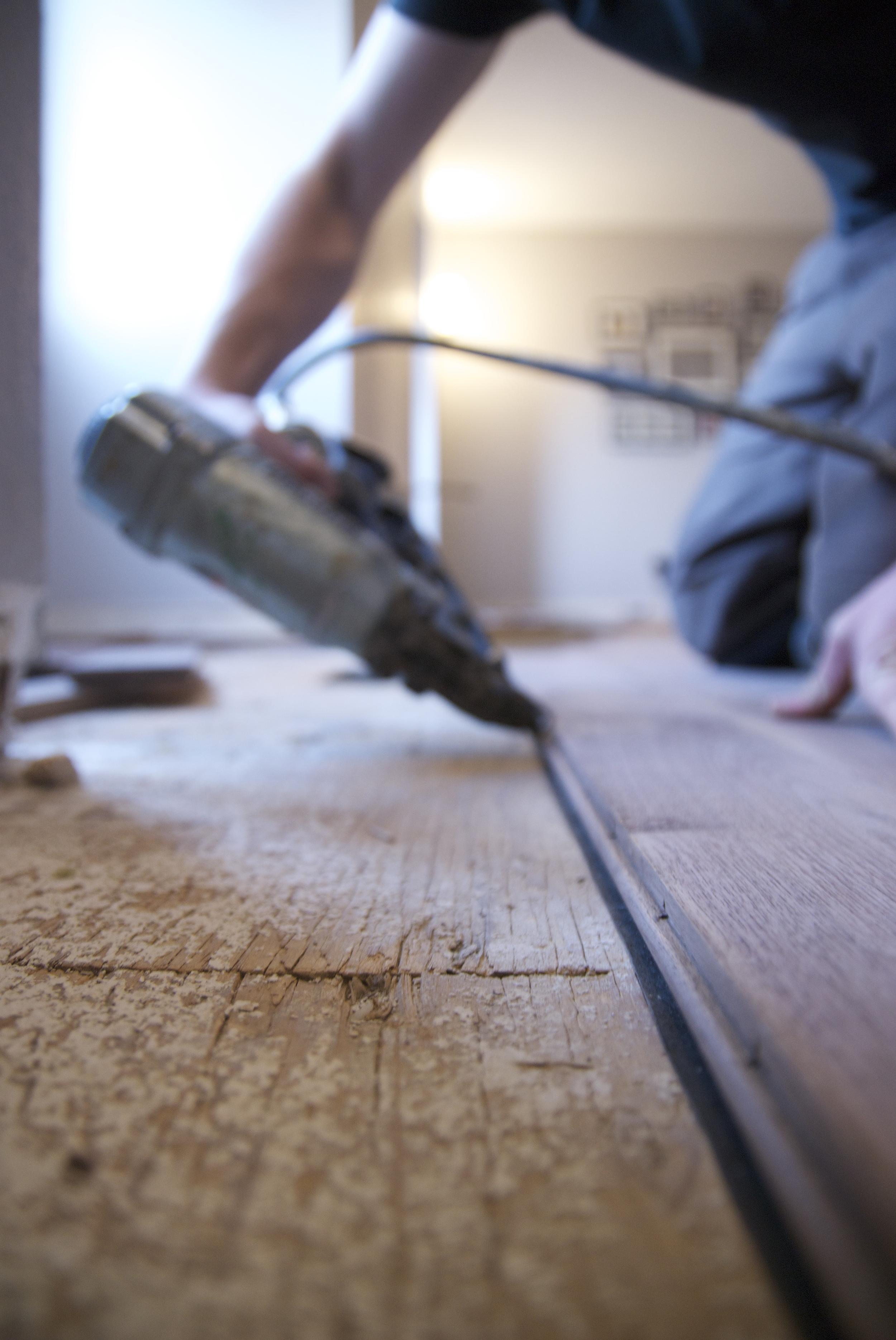 Steve Clifton of ASA Flooring installing hardwood floors in Denver