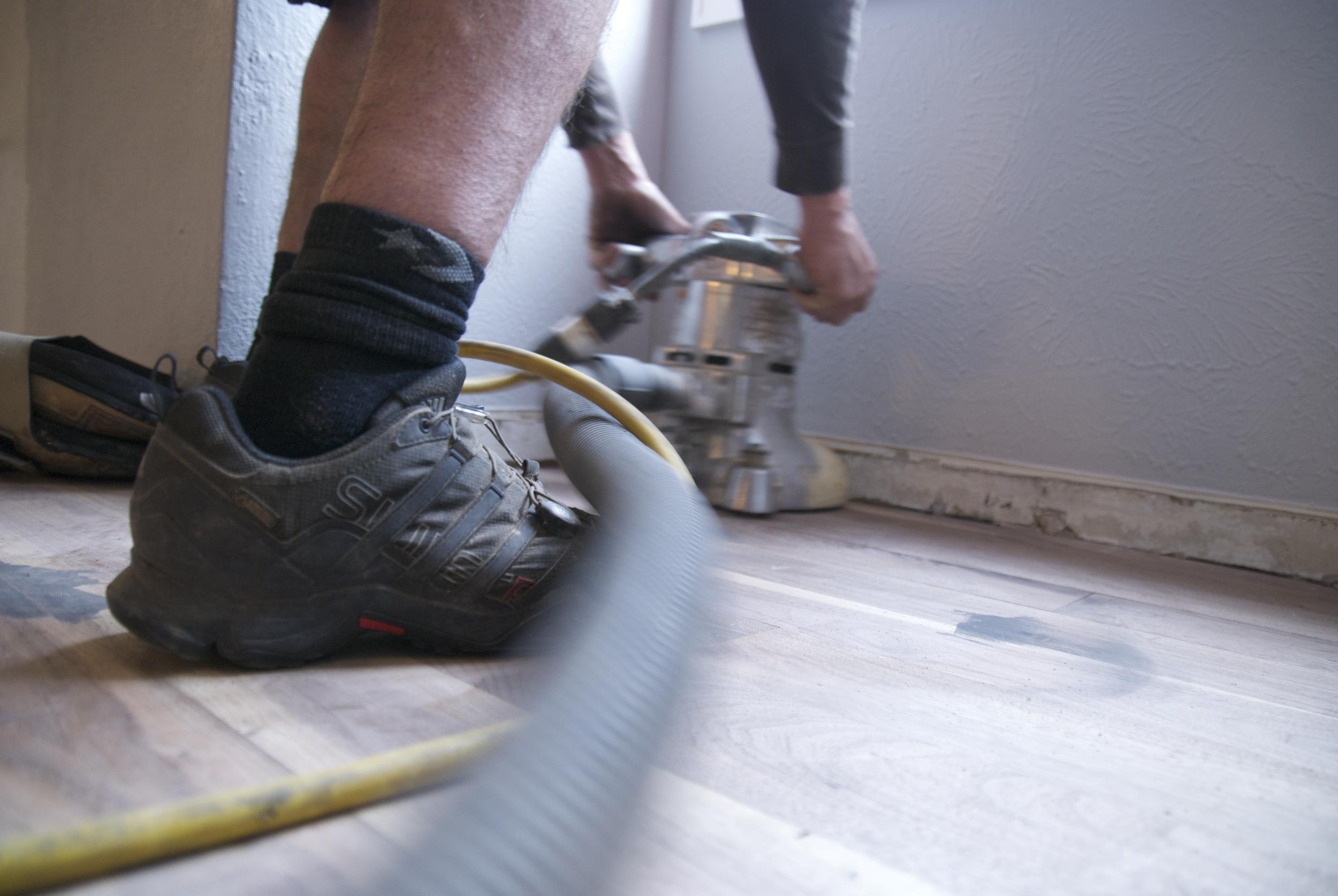 Steve Clifton of ASA Flooring sanding hardwood floors in Denver