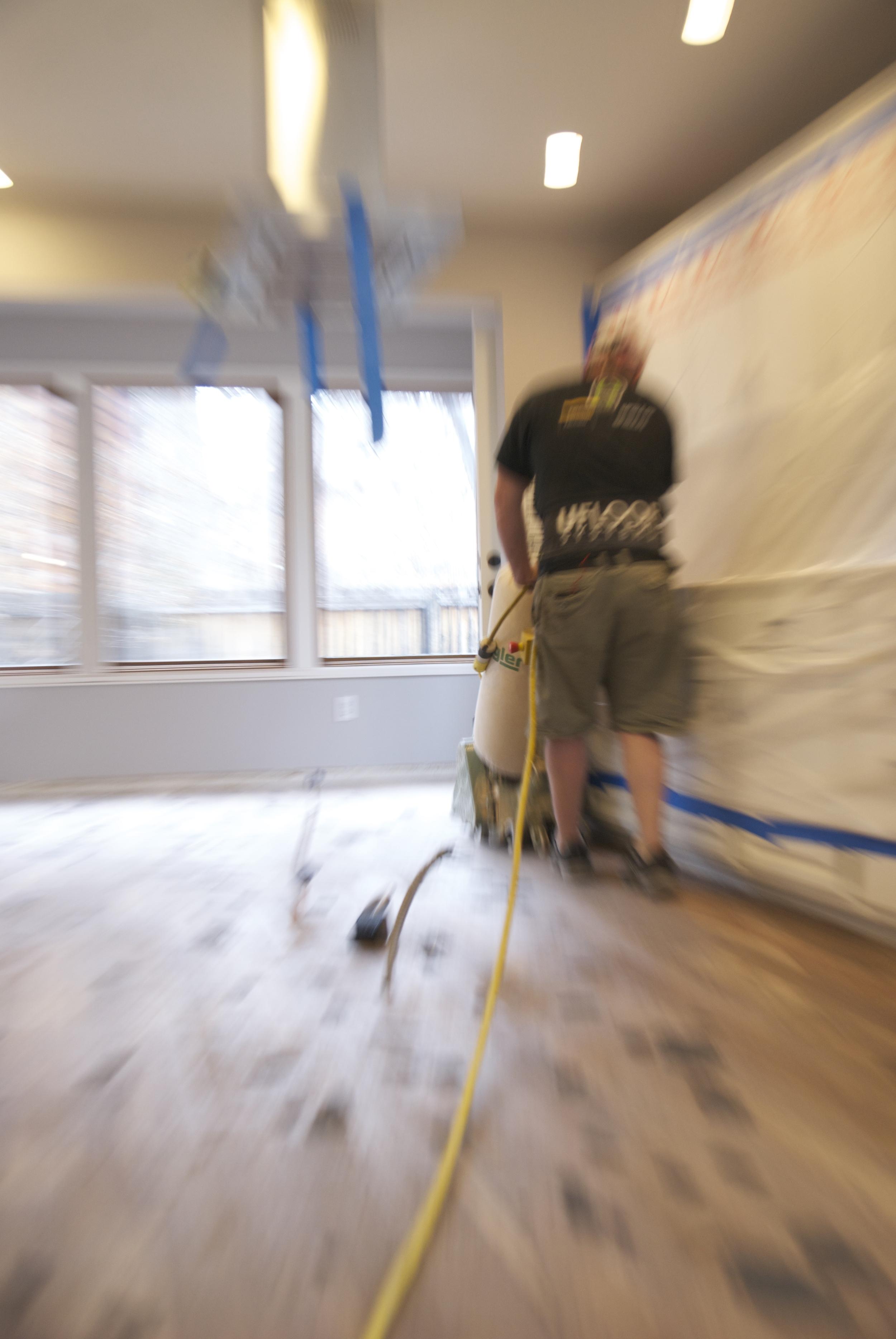 Steve Clifton of ASA Flooring polishing hardwood floors in Denver