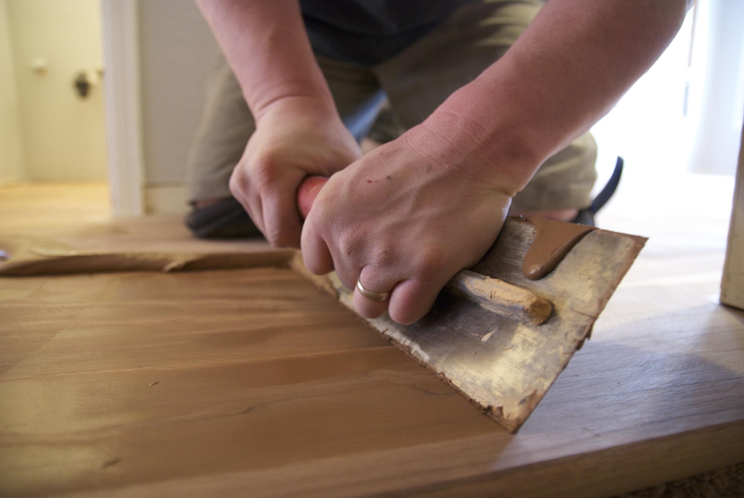 Steve Clifton of ASA Flooring putting final touches on hardwood floors in Denver