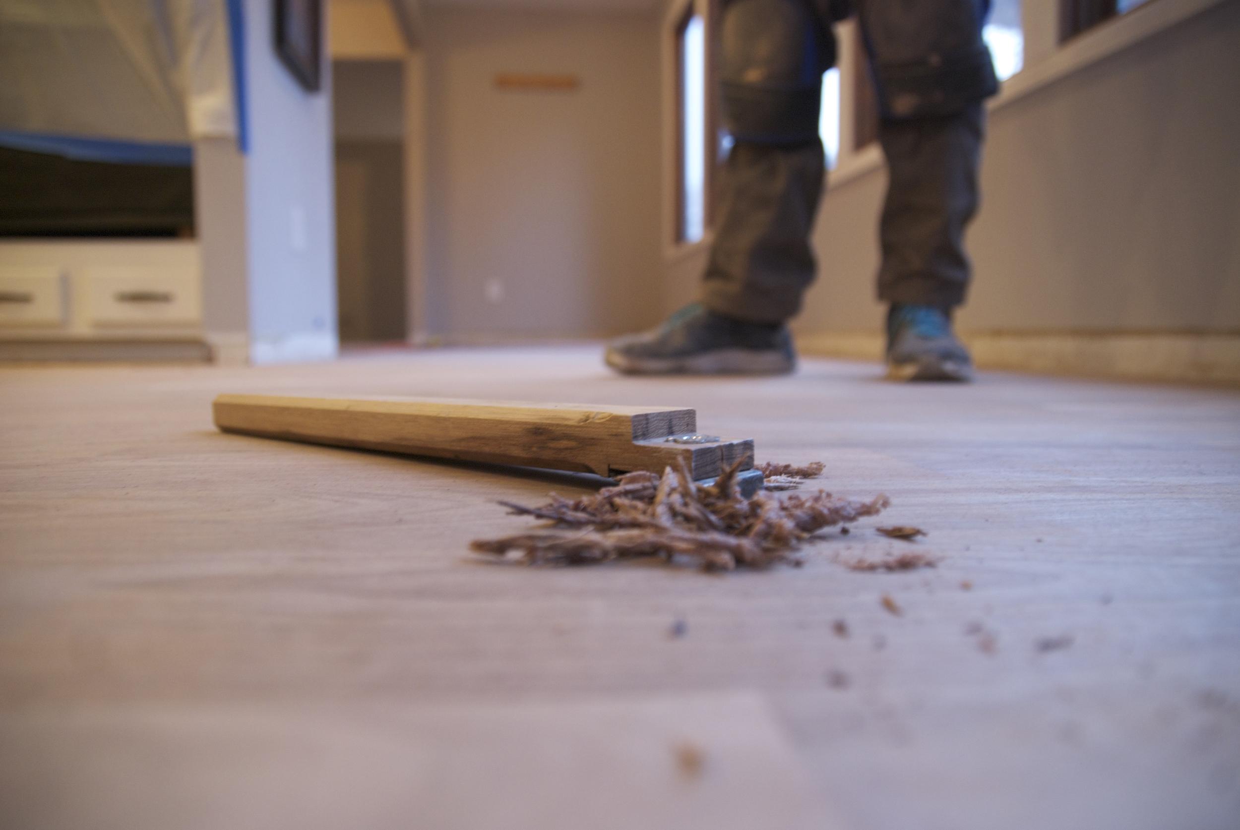 Steve Clifton of ASA Flooring evaluating hardwood floors in Denver
