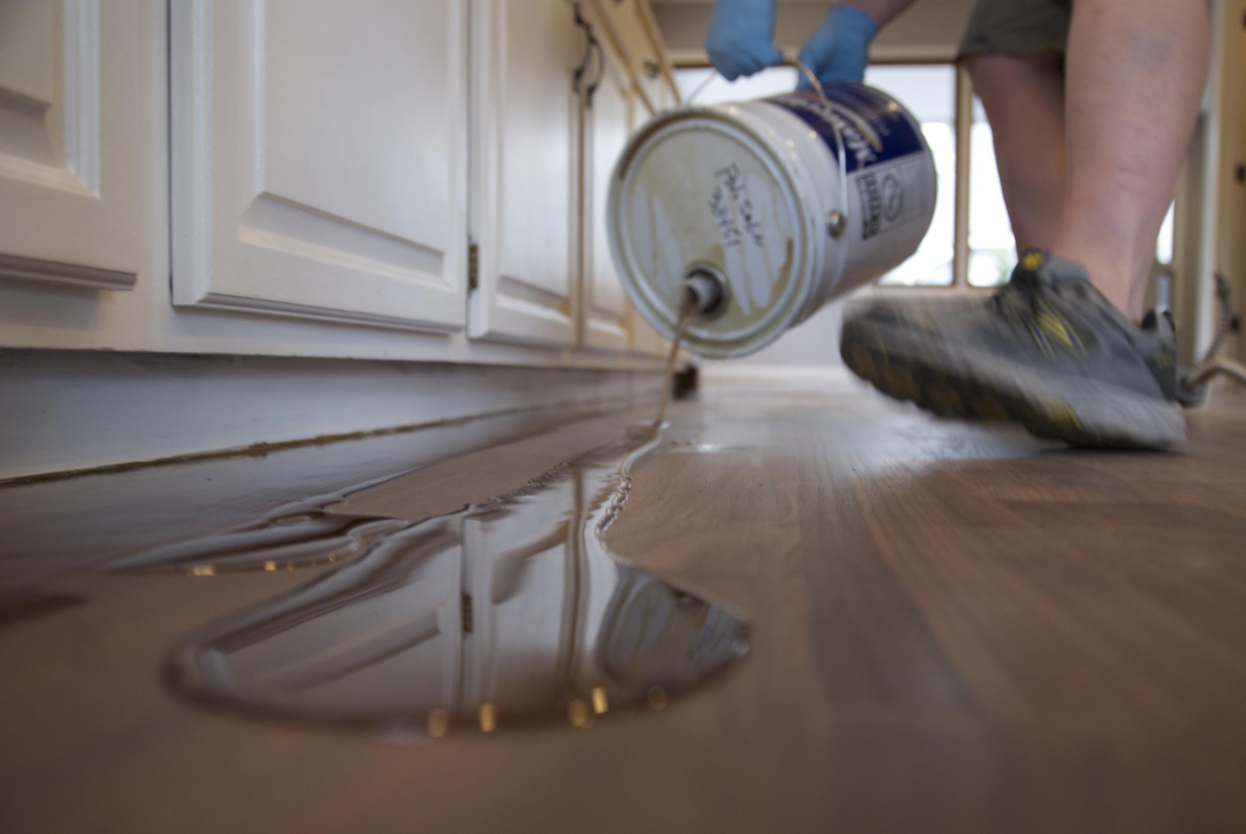 Steve Clifton of ASA Flooring oiling hardwood floors in Denver