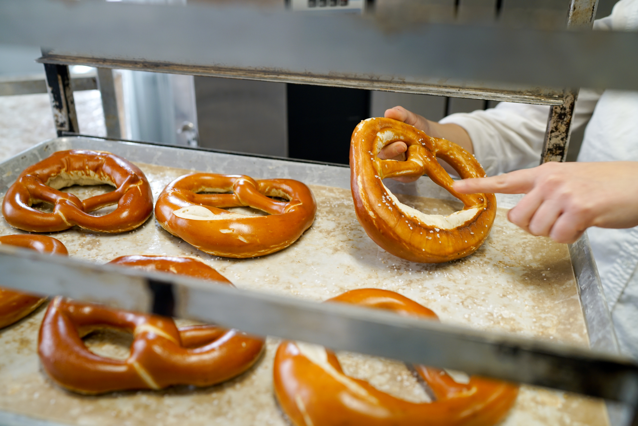 """Every pretzel made at the Bronx Baking Co. is finished by hand by one of the company's trained bakers. """"I can't figure out how to take the hands out of the process and maintain the quality, so it will be done like this forever."""" - Alexis Faraci, founder and owner of the Bronx Baking Co."""