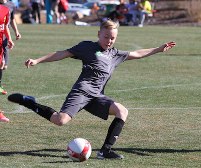 9U-11U MetaSport soccer player aiming for goal.