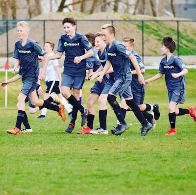 14U MetaSport boys team celebrates goal-winning game.