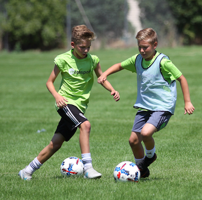 Two Utah players training in 12U-15U boys competitive soccer program.
